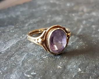 Single stone amethyst ring