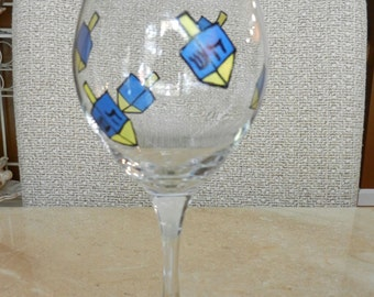 Hanukkah 12 oz wine glass hand painted with dreidels and star of David on the base