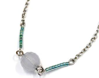 Iridescent blue bead and silver metal with Miyuki beads emerald green bracelet