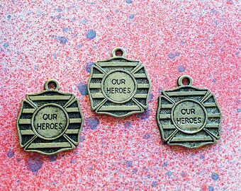 Our Heroes Charms --4 pieces-(Antique Pewter Silver Finish)--style 898-