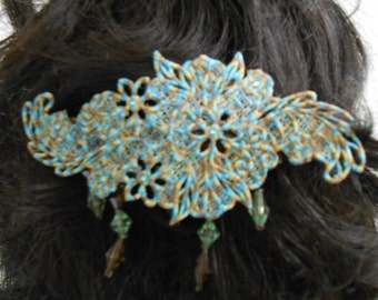 Shades of blue and brown with beaded trim barrette.