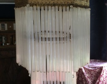 Antique French 1930s chandelier. Tubular glass in two tiers. Ornate tole, copper fixture and frames.