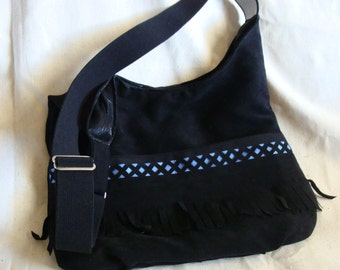 Soft black purse with fringe and a touch of blue