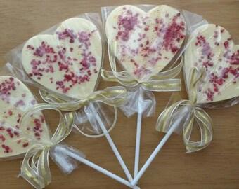 Belgian Chocolate heart lollipops with raspberry and gold stars .milk white dark