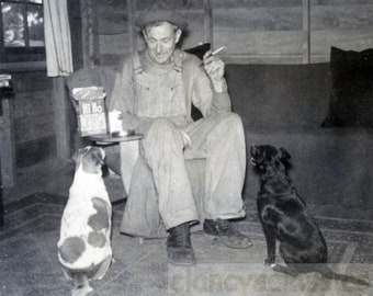 Vintage photo 1939 Cabin Older Man Smokes His Dogs Wait for HI HO crackers