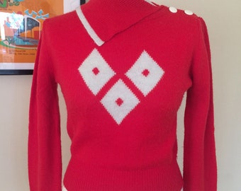 Sweater girl 1950s style red jumper. Harlequin motif, shoulder buttons and unusual collar