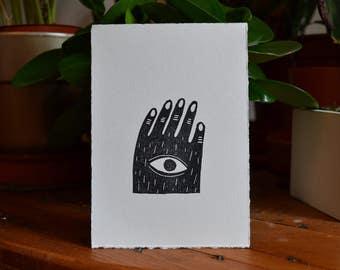 Card tamponee linocut hand Cyclops