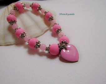 Pink and silver bracelet and its glazed pendant