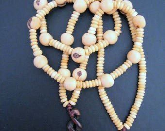 ETERNITY TWIST Wood Carving Amulet on NATURAL Seeds Bead Necklace