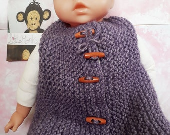 hand knitted baby girl gilet to fit a 1 year old, with wooden toggles  perfect for summer days