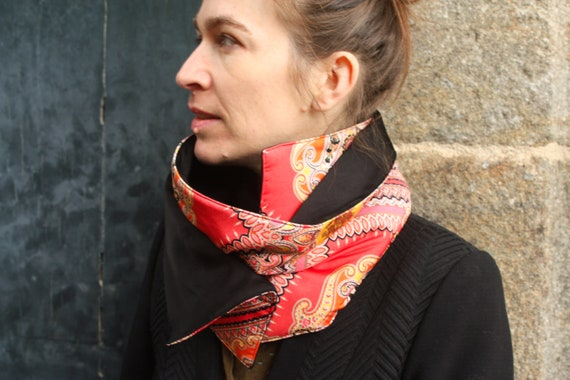 Promo Studio space. Cowl/scarf blanket cashmere orange/yellow patterned, double black silk and padded.