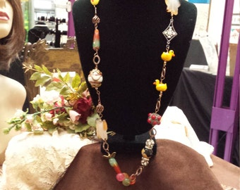 One strand assorted whimsy long bead necklace