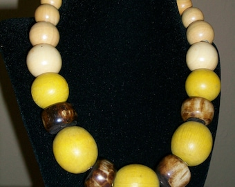 Mustard and Cream wood with bone beaded necklace.