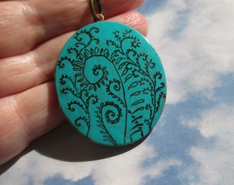 Fiddlehead Fern Art on verdigris oval vintage locket comes with brass chain