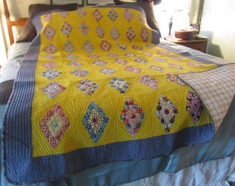 vintage quilt, bright yellow, navy blues and reds, very small hexigons
