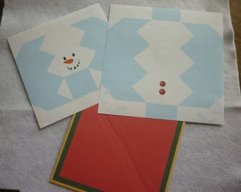 Origami Kit for creating a snowman and a prefitted scene background.