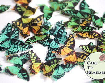 "24 yellow and green edible butterflies. 1.5"" across. Birthday cake topper, wafer paper butterflies for cupcake decorating or cake pops."