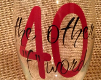 "40, the other ""f"" word wine glass."