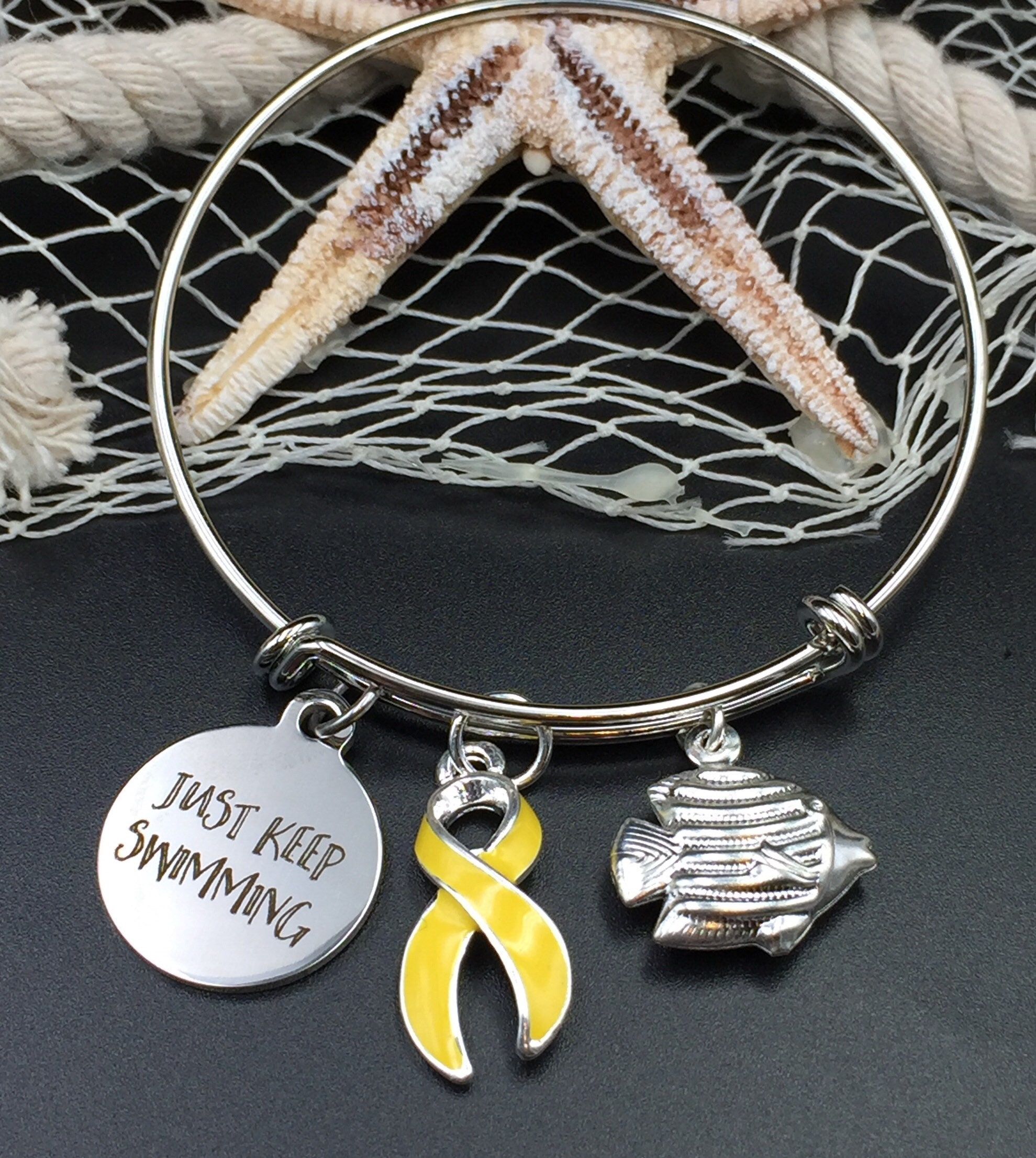 ribbon spina bifida cancer liver survivor charm yellow osteosarcoma pin adenosarcoma bladder bracelet endometriosis