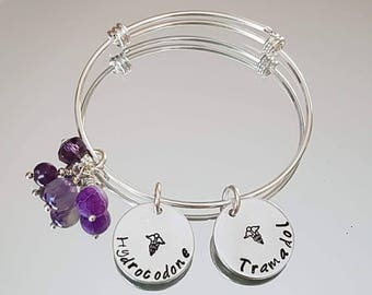 Medical info charms on silver plated sliding bangle. Personalised with anything that will fit