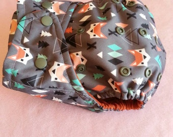 SassyCloth one size pocket cloth diaper with aztec fox PUL print. Made to order.