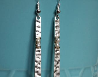 Silver hammered earrings with pearl accent