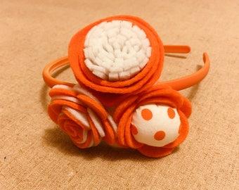 Beautiful orange 3 flowers headband for girls.