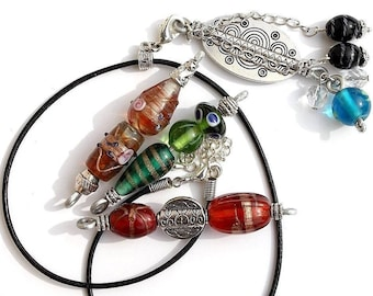 Ethnic necklace with four interchangeable Lampwork pendants on black leather cord