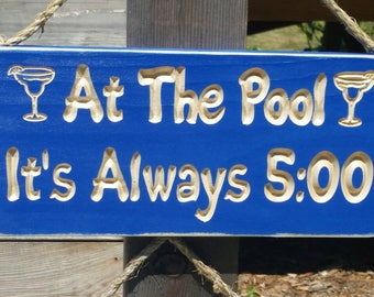 At the pool it's always 5:00 o'clock, pool signs,  pool decor, swimming pool signs,  custom made signs, outdoor pool signs, drinking signs