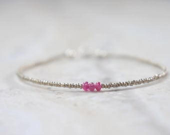 very tiny ruby beaded bracelet. very thin stackable ruby bracelet with chrome seed beads. ruby and seed beads bracelet
