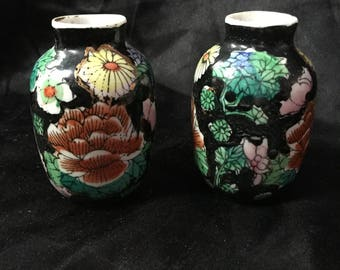 A pair of Chinese, miniature Mille fleur or famille noir vases