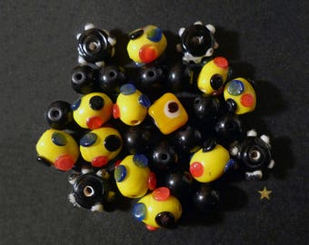 Indian yellow, various shapes black lampwork glass beads