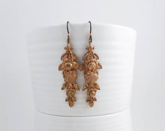 Romantic garden theme earrings made from vintage European copper stampings, on hypo-allergenic niobium ear wires
