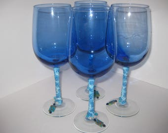 Wine glasses made with polymer clay and Millefiori glass jewelery