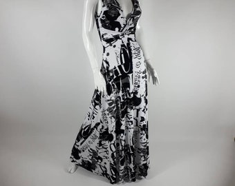 Maxi black and white sleeveless newsprint dress. This maxi dress is v neck and that has a string that criss-crosses under the bust.