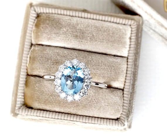 Natural Aquamarine and Diamond Halo Ring