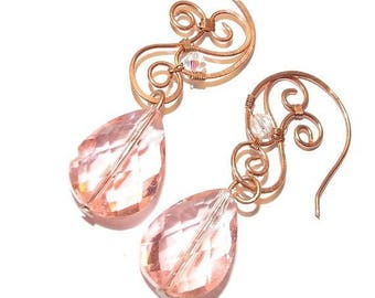 Earrings in antiqued copper and Crystal drops roses.