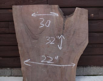 Dark walnut live edge slab. Customize and make the perfect piece!
