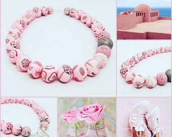 Uniquely created flower and other pattern polymer clay necklace in pretty pink color.