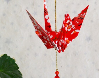 Origami Crane Hanging Ornament - red Japanese paper with flowers, hand varnished, on gold string with Swarovski crystals