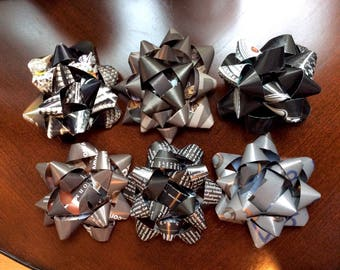 Six neutral toned, recycled gift bows in black and gray