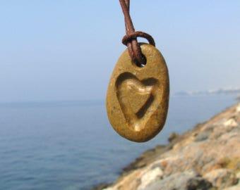 Cabo de gata beach stone pendant with heart carved