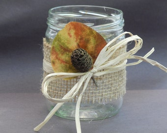 Upcycled glass jar decorated for fall