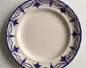 Antique flow blue plate with a garland of medalions, blue and white, collectible plates