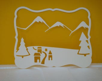 Cut out frame landscape mountain, houses and trees