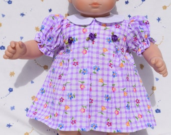 Cute purple and white plaid dress in a colorful flower print with white collar fits 15 inch baby dolls