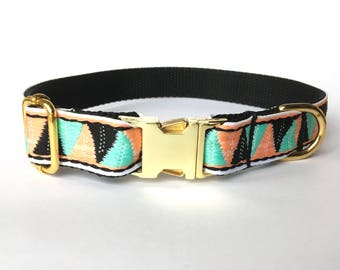 dog collar: woven pink, green and black triangles on black nylon webbing. Gold or plastic slip buckle
