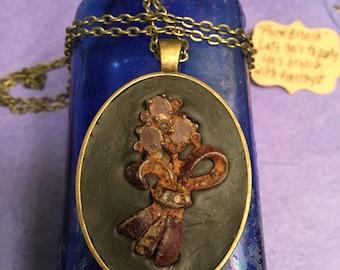 Floral Brooch artifact pendant