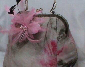 Handbag, made of silk and feathers.