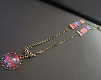 Bronze necklace with ethnic fabric, chain and cabochon